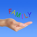 Family letter and hand. FAMILY letter flying above a hand on blue sky royalty free stock photo