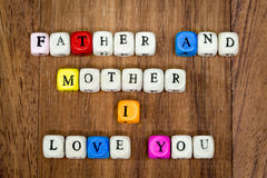 Family letters. On wood background. Family is mean father and mother i love you Stock Photos