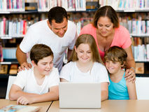 Family in library Royalty Free Stock Photography