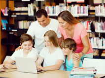 Family in library Royalty Free Stock Images
