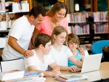 Family in library Royalty Free Stock Image