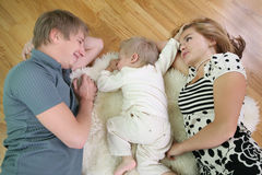 Family lie on floor 2 Stock Photos