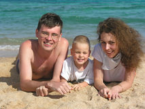 Family lies on beach 2 Stock Images