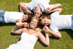 Family lies on grass Royalty Free Stock Image