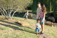 Family Life. Happy american family, a diverse one, outside enjoying nature and spending time together. Family at the park stock photography