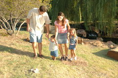 Family Life. Happy american family, a diverse one, outside enjoying nature and spending time together. Family at the park stock photo