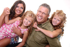 Family life. Happy parents with two daughters Stock Photos