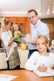 Family life - children doing school work Royalty Free Stock Photo
