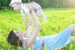 Family Life Concepts. Portrait of Mother with Her Toddler Son Playing Outdoor in Park. Horizontal Image Orientation Royalty Free Stock Photos