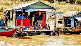 Family life in a flotating village on Tonle Sap lake. Tonle Sap Lake Siem Reap, Cambodia - July 13, 2013: Cambodian people live on Tonle Sap Lake in Siem Reap Royalty Free Stock Photo