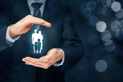 Family life insurance and policy. Family life insurance, family services and supporting families concepts. Businessman with protective gesture and silhouette Stock Image