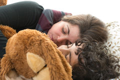 Family life.Single mother sleeping with son Stock Photos