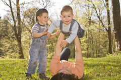 Family lifestyle. Portrait of a mom with their two kids having fun outdoors Royalty Free Stock Photo