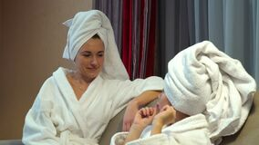Family lifestyle communication bonding chatting. Happy family lifestyle. mother and daughter bonding communication. chatting after bath time stock video footage