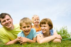 Family lifestyle portrait. Of a mum and dad with their daughter and son  having good time Stock Images