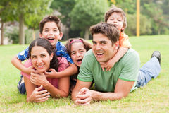 Family lifestyle portrait. Of a mum and dad having fun with their kids Royalty Free Stock Photos