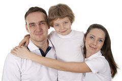 Family lifestyle portrait. Young European family from three persons - mother, father and son Royalty Free Stock Photos