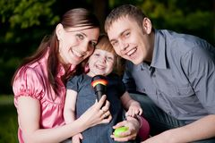 Family Lifestyle Portrait. Of A Mum And Dad With Their Kid Having Fun Outdoors Stock Images