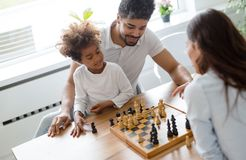 Family lifestyle portrait of a mum and dad with their kid. Having fun Royalty Free Stock Photos