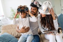 Family lifestyle portrait of a mum and dad with their kid. Having fun Stock Photography