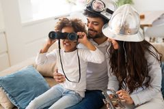 Family lifestyle portrait of a mum and dad with their kid. Having fun Stock Image