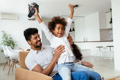 Family lifestyle portrait of a mum and dad with their kid. Having fun Royalty Free Stock Photography