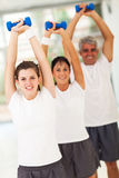 Family lifting dumbbells Stock Image