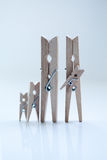 The family of linen clothespins. Royalty Free Stock Image