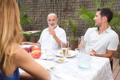 Family listen to father while talking in garden Royalty Free Stock Image