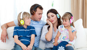 Family listening music with headphones Stock Photography
