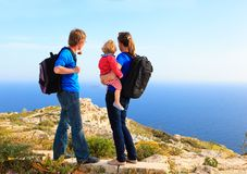 Family with little baby hiking in summer mountains Royalty Free Stock Photos
