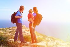 Family with little baby hiking in summer mountains Stock Images