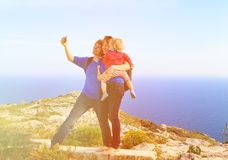 Family with little baby making selfie while hiking Stock Images