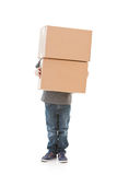 Family: Little Boy Carries Stack of Moving Boxes Stock Photography