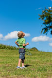 Family - little boy playing badminton outdoors. On a summer day stock photography