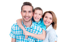 Family with little boy and pretty white smiles Royalty Free Stock Images