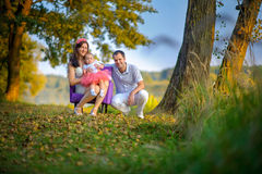 Family with the little daughter outdoors royalty free stock photography