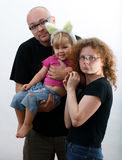 Family with little daughter separately Royalty Free Stock Image