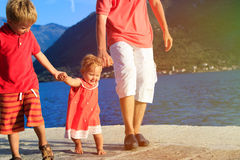 Family with little daugther learning to walk on vacation Royalty Free Stock Images