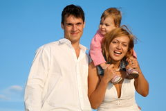 Family with little girl Stock Images