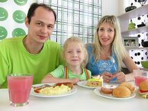Family with the little girl in cafe Royalty Free Stock Photography