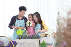 Family with little girl in Play gardening. Backlit shot Stock Photography