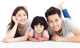 Family with little girl  playing on the floor Royalty Free Stock Photography