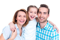 Family with little girl and pretty white smiles. Caucasian happy young family with little girl and pretty white smiles - looking at camera royalty free stock photos