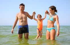Family with little girl in sea Stock Photo