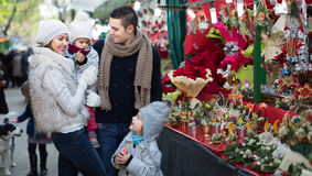 Family with little girls at floral market Stock Photos