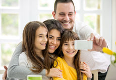 Family with little girls making self portrait Royalty Free Stock Image