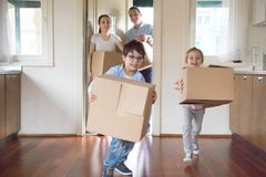 Family with little kids arrive at new home royalty free stock photography