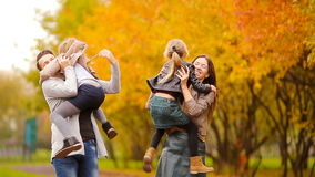 Family with little kids in autumn park enjoy warm day stock footage
