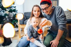 Family and little son playing home on Christmas holidays. New Year holidays Royalty Free Stock Image